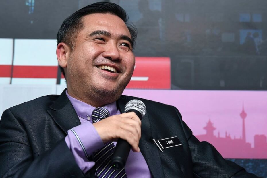 Anthony Loke, Malaysian Transport Minister laughing and smiling
