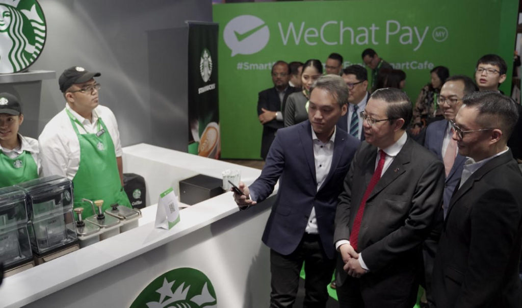 Mr Jason Siew CEO WeChat Pay Malaysia demonstrates Starbucks e-wallet payment